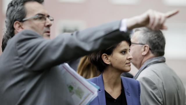 La ministre de la Ville Najat Vallaud-Belkacem en visite le 4 avril 2014 à Pantin avec le maire de de la ville Bertrand Kern [Kenzo Tribouillard / AFP/Archives]