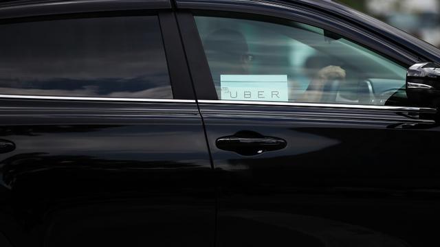 Un véhicule Uber circulant dans le quartier de Manhattan le 20 juin 2015 à New York  [Spencer Platt / GETTY IMAGES NORTH AMERICA/AFP/Archives]