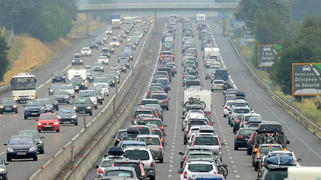 Bison Futé recensait samedi matin déjà 220 km de bouchons pour une journée classée noire dans le sens des départs et rouge dans celui des retours [Philippe Desmazes / AFP/Archives]