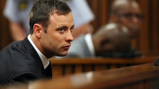 Le champion paralympique sud-africain Oscar Pistorius lors de son procès pour le meurtre de sa petite amie, le 12 septembre 2014 au tribunal de Pretoria [SIPHIWE SIBEKO / POOL/AFP/Archives]