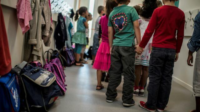 Des écoliers  en rang le jour de la rentrée scolaire le 3 septembre 2013 à Lyon  [JEFF PACHOUD / AFP/Archives]