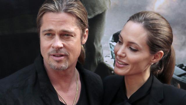 Brad Pitt et Angelina Jolie sur les Champs Elysées à Paris le 3 juin 2013 [Jacques Demarthon / AFP/Archives]
