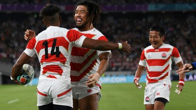 La joie des Japonais après un essai face à la Russie, en match d'ouverture de la Coupe du monde, le 20 septembre 2019 à Tokyo [CHARLY TRIBALLEAU / AFP]