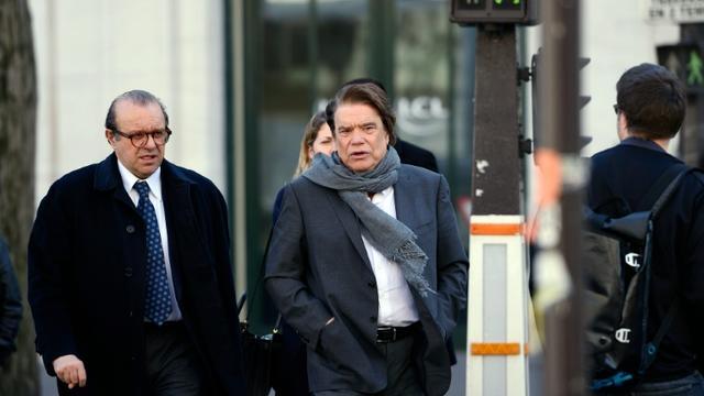 Bernard Tapie (C) et son avocat Hervé Temime le 12 mars 2015 à Paris [ERIC FEFERBERG / AFP/Archives]