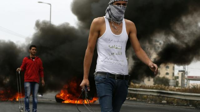 Un manifestant palestinien le 23 octobre 2015 àAl-Bireh [ABBAS MOMANI / AFP]
