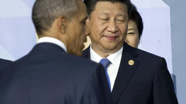 Le président américain Barack Obama (à gauche) et le président chinois Xi Jinping à Manille le 19 novembre 2015 [SAUL LOEB / AFP/Archives]
