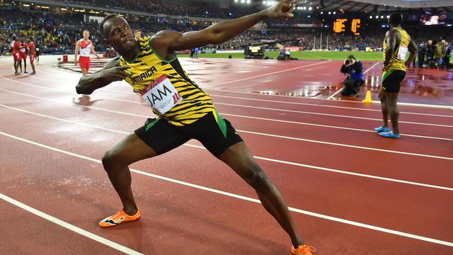 Le sprinteur jamaïquain Usain Bolt après sa victoire sur le 4x100 m relais aux jeux du Commonwealth à Glasgow, le 2 août 2014   [Ben Stansall / AFP/Archives]