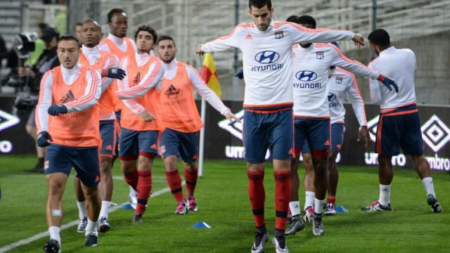 Les joueurs de l'OL à l'échauffement à La Beaujoire avant d'affronter le FC Nantes, le 1er décembre 2015 [JEAN-SEBASTIEN EVRARD / AFP/Archives]