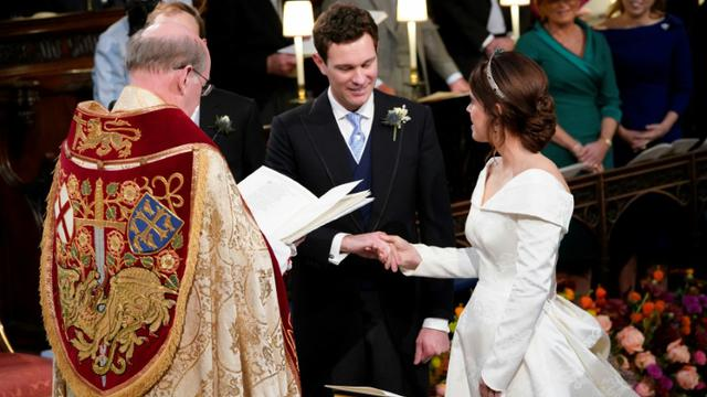 La princesse Eugenie et son compagnon Jack Brooksbank se marient à Windsor, le 12 octobre 2018. [Danny Lawson / POOL/AFP]
