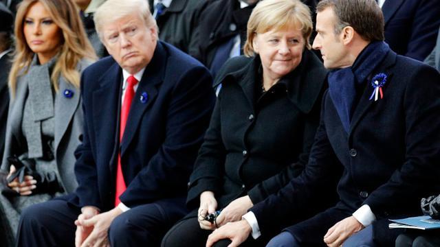 Le président américain Donald Trump, la chancelière allemande Angela Merkel et le président français Emmanuel Macron à Paris le 11 novembre 2018 [Francois Mori / POOL/AFP/Archives]