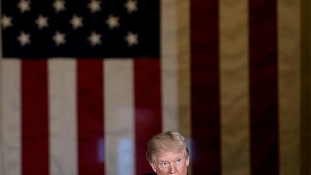 Donald Trump au cours d'une cérémonie d'hommage à un ancien sénateur républicain au Capitole, le 17 janvier 2018 [Brendan Smialowski / AFP]