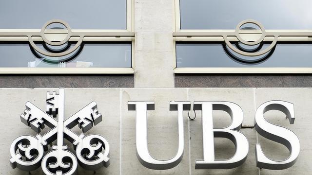 Le logo de la banque suisse UBS au siège de sa filiale UBS Belgique à Bruxelles le 19 juin 2014 [Laurie Dieffembacq / Belga/AFP]