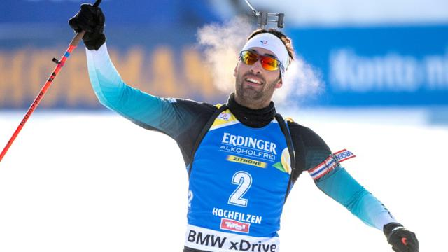 Le Français Martin Fourcade remporte la poursuite lors du biathlon d'Hochfilzen le 15 décembre 2018 [JOE KLAMAR / AFP]