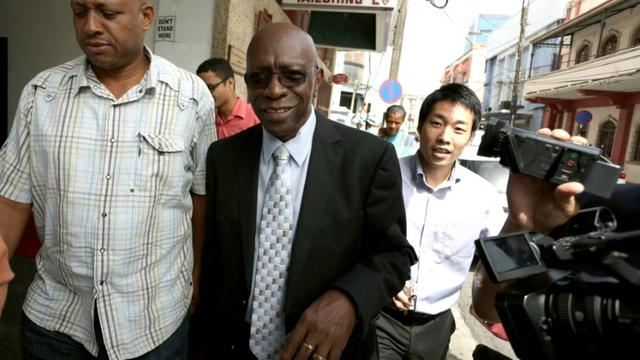 L'ancien vice-président de la Fifa Jack Warner (c), le 9 juillet 2015 à Port-of-Spain [ALVA VIARRUE / AFP/Archives]