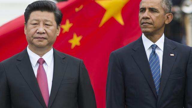 Les présidents chinois Xi Jinping et américain Barack Obama à la Maison Blanche, le 25 septembre 2015 [Saul LOEB / AFP]