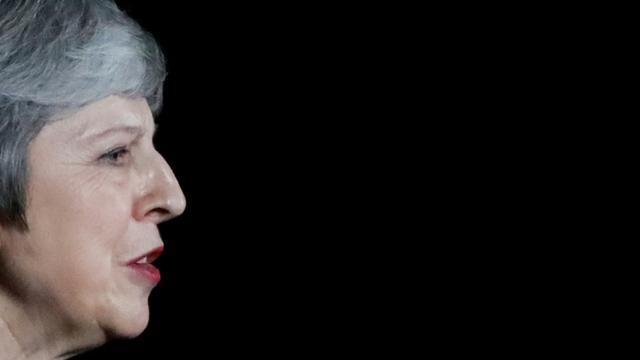 Theresa May doit convaincre le Parlement britannique qui votera en décembre pour ou contre le projet d'accord élaboré avec l'Union européenne mardi (photo prise lors de sa déclaration à la presse le 14 novembre 2018 à Londres) [Tolga AKMEN / AFP]