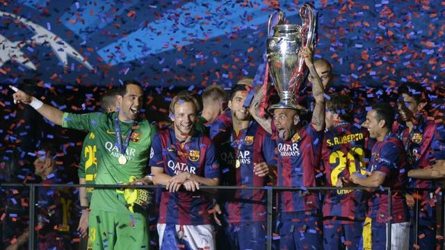 Les joueurs du FC Barcelone célèbrent leur victoire en finale de la précédente édition de la Ligue des champions, contre la Juventus, le 6 juin 2015 à Berlin [OLIVER LANG / AFP/Archives]