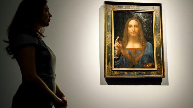 """Le tableau """"Salvator Mundi"""" de Léonard de Vinci exposé à Londres le 22 octobre 2017  [Tolga Akmen / AFP/Archives]"""