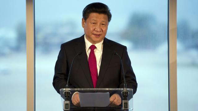 Xi Jinping, le président chinois, le 23 octobre 2015, à Manchester [Oli Scarff / AFP/Archives]