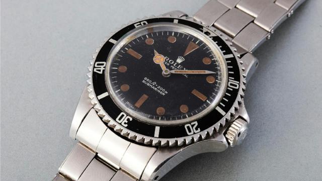 """La montre Rolex Submariner portée par Roger Moore dans le film de James Bond """"Live and Let Die"""" vendue aux enchères à Genève par la maison Phillips le 9 novembre 2015 [ / Maison d'enchères PHillips/AFP]"""