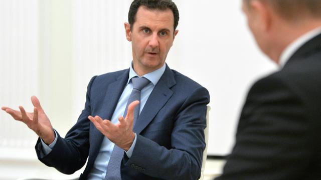 Bachar al-Assad reçu par Vladimir Poutine le 20 octobre 2015 au Kremlin à Moscou [ALEXEY DRUZHININ / RIA NOVOSTI/AFP/Archives]