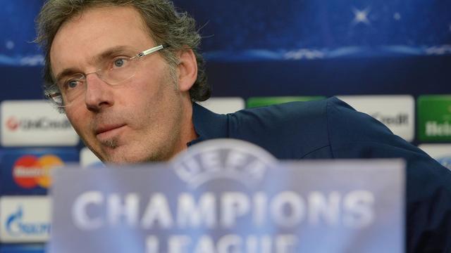 e39fcc4914f388 L entraîneur parisien Laurent Blanc en conférence de presse le 17 février  2014 à Leverkusen
