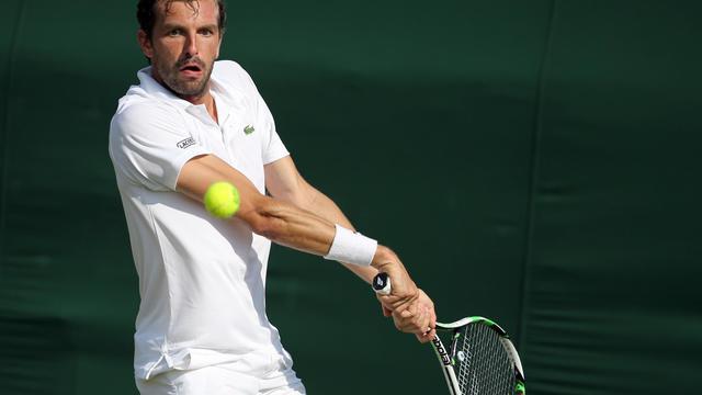 Julien Benneteau, ici lors du 1er tour de Wimbledon, le 24 juin 2014 à Londres [Andrew Cowie / AFP/Archives]