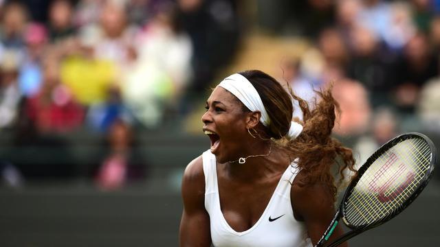 Serena Williams lors de son match contre Alize Cornet à le 28 juillet 2014 [Carl Court / AFP]