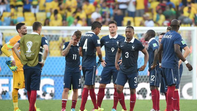 L'équipe de France après sa défaite en quart de finale du Mondial contre l'Allemagne, le 4 juillet 2014 à Rio [Patrik Stollarz / AFP]