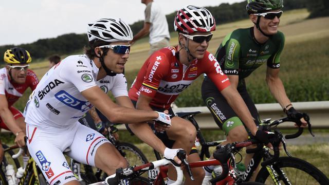 Thibaut Pinot (g), Tony Gallopin (c) et Pierre Rolland lors de la 21e et dernière étape du Tour de France, le 27 juillet 2014 entre Evry et Paris [Eric Feferberg / AFP]