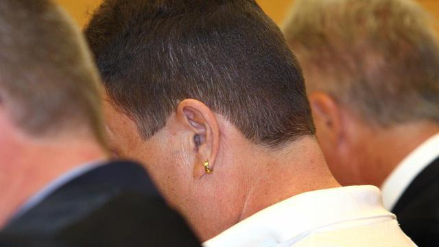 Le chauffeur Michael Harry K à l'arrivée de son procès le 11 août 2014 au tribunal de Wuerzburg, dans le sud de l'Allemagne [Karl-Josef Hilsenbrand / DPA/AFP]