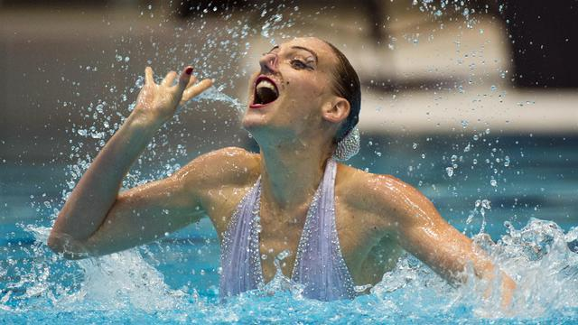 La performance de la Russe Svetlana Romashina le 15 août 2014 à Berlin [John Macdougall / AFP]
