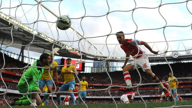 Aaron Ramsey inscrit le but de la victoire pour Arsenal face à Crystal Palace, le 16 août 2014 à l'Emirates Stadium [Carl Court / AFP]