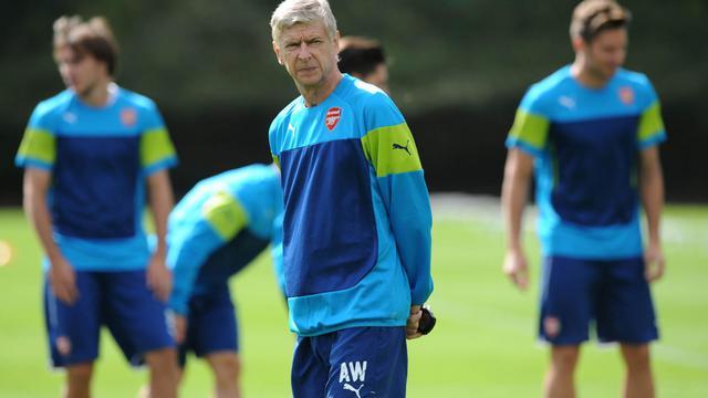 Arsène Wenger lors d'un entraînement d'Arsenal au nord de Londres, le 18 août 2014 [Olly Greenwood / AFP]