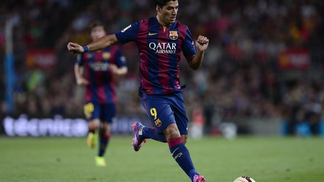L'attaquant Luis Suarez lors de ses débuts avec le FC Barcelone en amical à l'occasion du Trophée Gamper, le 18 août 2014  au Camp Nou [Josep Lago / AFP]