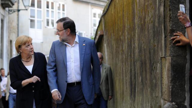 Angela Merkel et le Premier minstre espagnol Mariano Rajoy le 24 août 2014 à Saint-Jacques de Compostelle [Miguel Riopa / AFP]