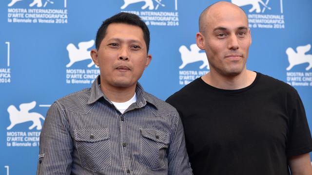Le réalisateur américain Joshua Oppenheimer et Adi Rukun, à la 71e mostra de Venise le 28 août 2014  [Tiziana Fabi / AFP]
