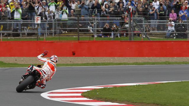 Le pilote espagnol Marc Marquez (Honda), vainqueur du GP de Grande-Bretagne, le 31 août 2014 à Silverstone [Ian Kington / AFP]