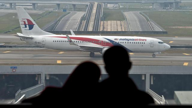 Un avion de la Malaysia Airlines sur le tarmac de l'aéroport le 27 juillet 2014 à Kuala Lumpur [Manan Vatsyayana  / AFP/Archives]