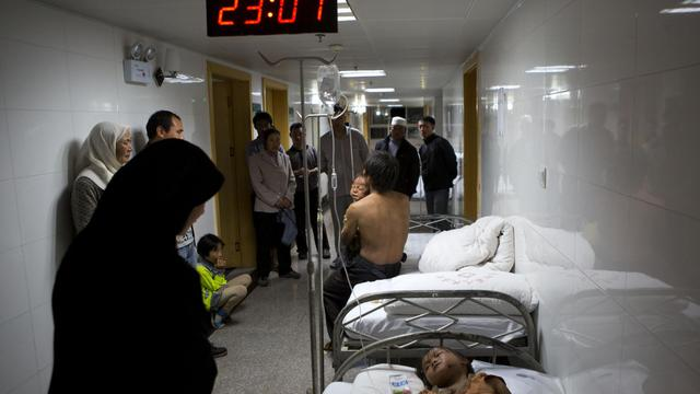 Des victimes du tremblement de terre qui a frappé le Yunnan dans un hôpital de Zhaotong, le 3 août 2014 [ / AFP]