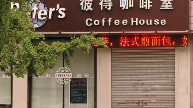 Le café, aujourd'hui fermé, tenu par les deux Canadiens Kevin Garratt et Julia Dawn, à Dandong, en Chine, près de la frontière avec la Corée du Nord [ / AFP]