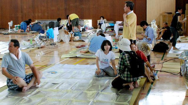 Des habitants d'Hiroshima réfugiés le 21 août 2014, après des coulées de boue la veille [ / Jiji Press/AFP]
