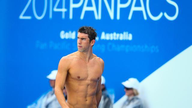 Michael Phelps lors du 100 m nage libre des Championnats PanPacifiques 2014 le 22 août à Gold Coast [Patrick Hamilton / AFP]