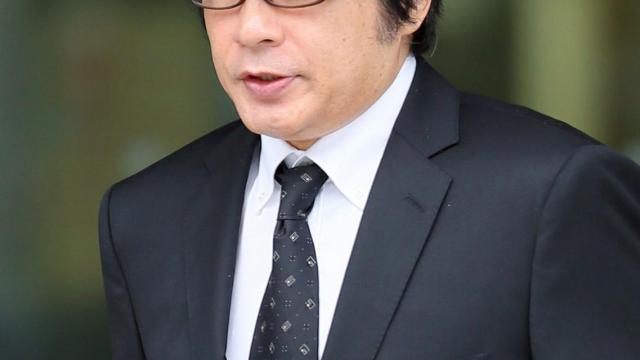 Le chanteur japonais Aska, libéré sous caution, le 3 juillet 2014 à Tokyo, après son arrestation pour usage de stupéfiants [JIJI PRESS / JIJI PRESS/AFP]
