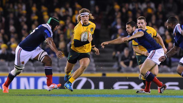 L'Australien Nick Cummins, lors d'un match contre la France, le 14 juin 2014 à Melbourne [Mal Fairclough / AFP]