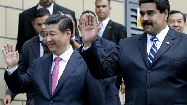 Le président vénézuélien Nicolas Maduro (droite) et le président chinois Xi Jinping (gauche) à Caracas le 21 juillet 2014 [Leo Ramirez / AFP]
