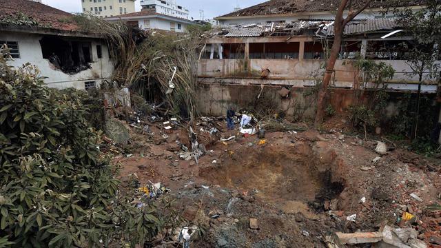Le site du crash du Cessna 560XL qui transportait le candidat à la présidentielle Eduardo Campos, à Santos dans l'Etat de Sao Paulo le 14 août 2014 [Neslon Almeida / AFP]