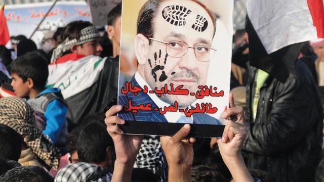 """Des Irakiens sunnites qualifient le Premier ministre sortant Nouri al-Maliki de """"menteur... sectaire, voleur, collaborateur"""", à Ramadi, en janvier 2012 [Azhar Shallal / AFP/Archives]"""