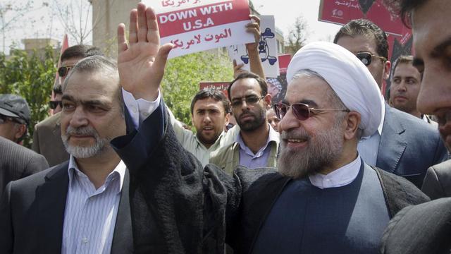 Le nouveau président iranien Hassan Rohani (d), le 2 août 2013 à Téhéran [Atta Kenare / AFP]