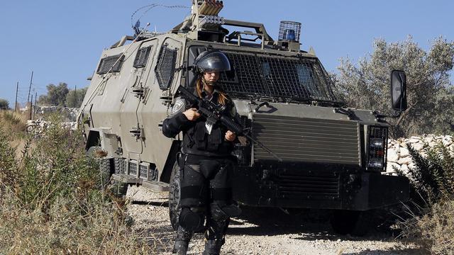 Une soldate israélienne le 31 juillet 2014 à la frontière avec la Bande de Gaza  [Abbas Momani / AFP]